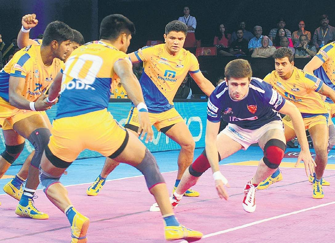 Action from the match between Tamil Thalaivas and Dabang Delhi. | File PTI