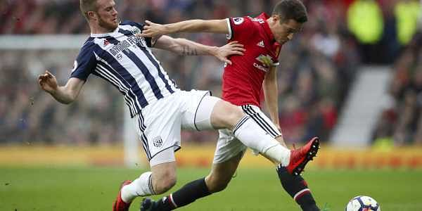 West Bromwich Albion's Chris Brunt, left, and Manchester United's Ander Herrera battle for the ball during the English Premier League match at Old Trafford, Manchester, England. (AP)