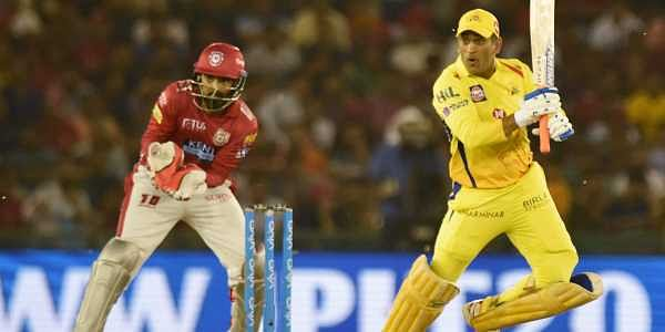 Chennai Super Kings captain M S Dhoni plays a shot during IPL T 20 match against Kings XI Punjab in Mohali. | PTI