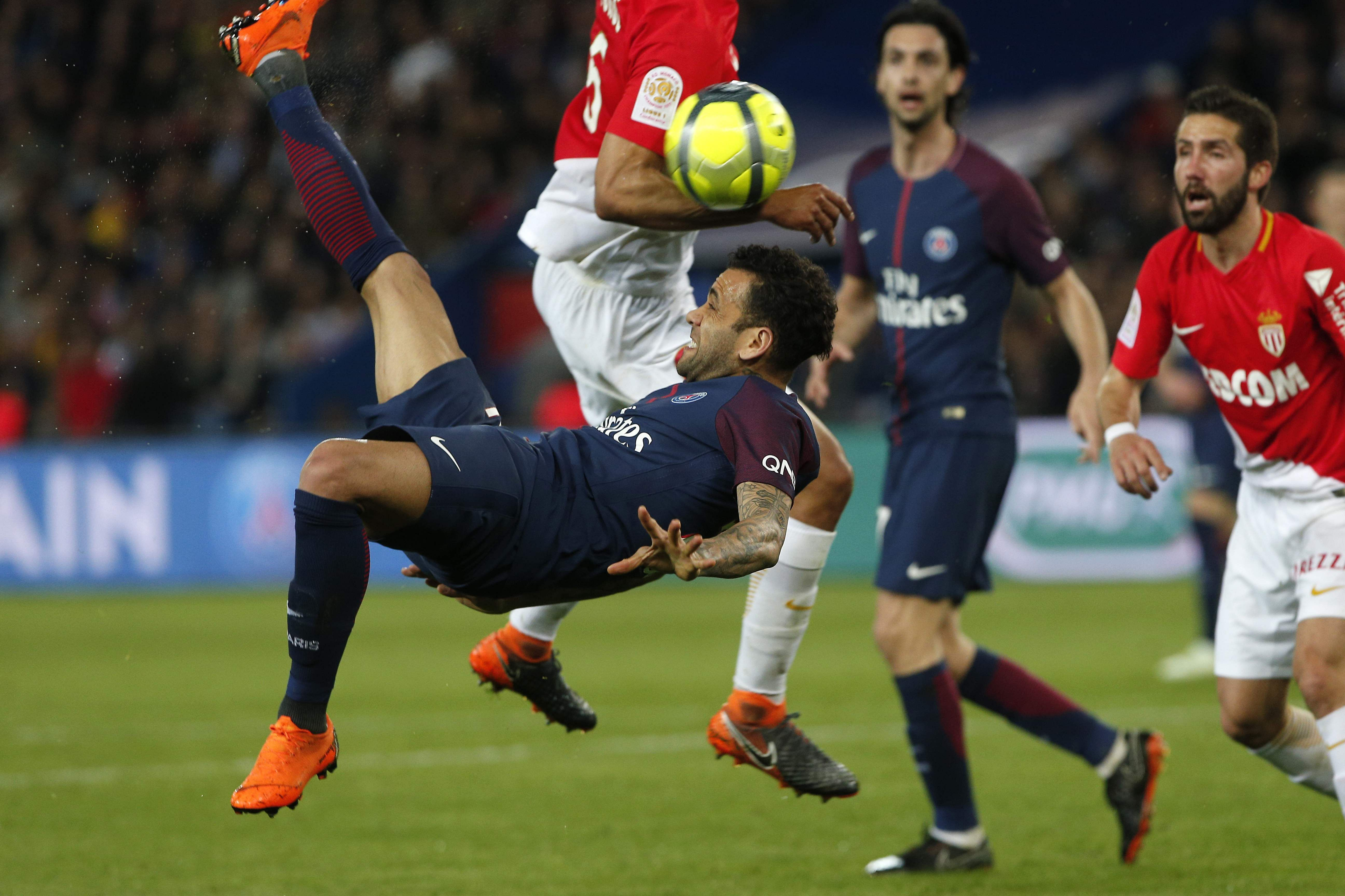 Paris Saint Germain's Dani Alves tries to score with a bicycle kick during the French League One match against Monaco. (AP)