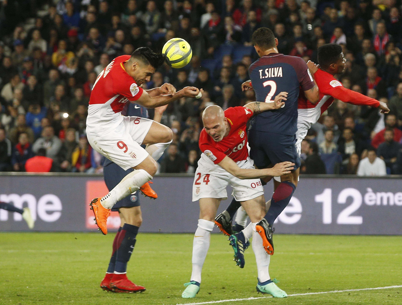 Monaco's Radamel Garcia scores an own goal with a header putting the score at 6-1 for Paris Saint Germain. (AP)