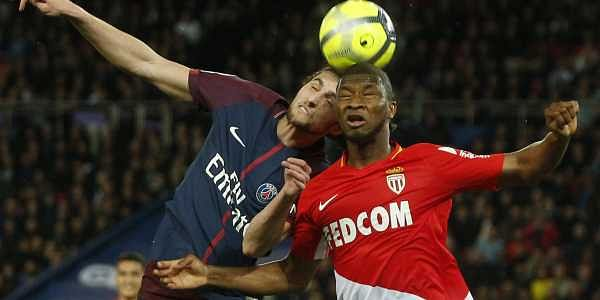 Monaco's Almamy Toure, right, and Paris Saint Germain's Adrien Rabiot, left, head the ball during the French League One match between Paris Saint Germain and Monaco at the Parc des Princes stadium in Paris, France. (AP)