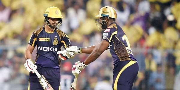 KKR batsman Nitish Rana and A.Russsell greets each other to built up their partnership during IPL Match against DD at eden garden in Kolkata on Monday . | PTI