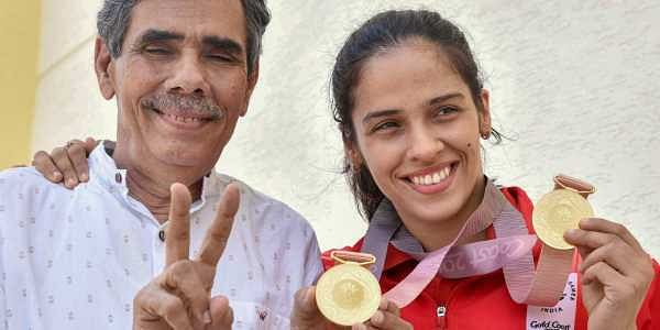 Gold medallist shuttler Saina Nehwal with her father Harvir Singh at a press conference in Hyderabad on Tuesday. | PTI