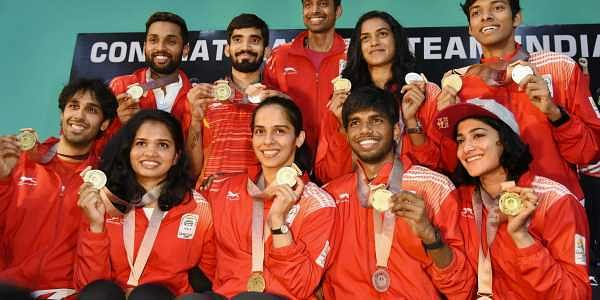 Shuttlers Saina Nehwal Kidambi Srikanth PV Sindhu and other players show their Commonwealth medals at a press conference in Hyderabad on Tuesday. Coath Gopichand is also seen. | PTI