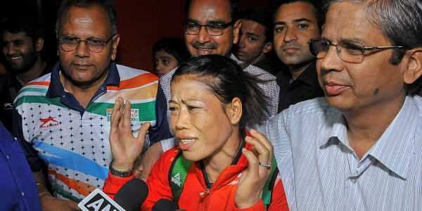 Commonwealth Games gold medallist boxer MC Mary Kom talks to the media on her arrival the airport in New Delhi on Tuesday. | PTI