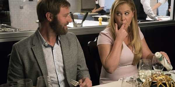 This image released by STX Films shows Rory Scovel, left, and Amy Schumer in a scene from 'I Feel Pretty.' | AP