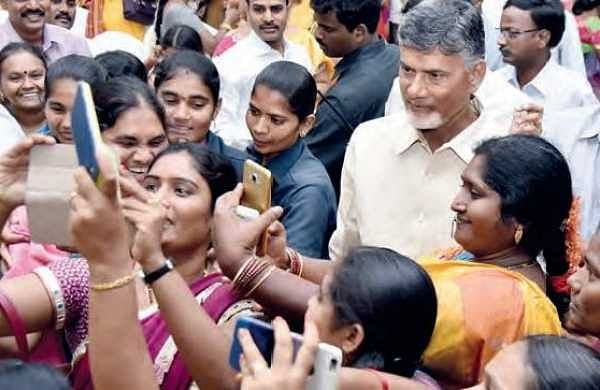 Women take selfies with CM N Chandrababu Naidu after he launched the Chandranna Pelli Kanuka programme at CM's residence in Undavalli on Wednesday | EXPRESS