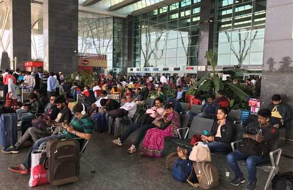 People stranded at Bengaluru International Airport. (Nagaraja Gadekal | EPS)