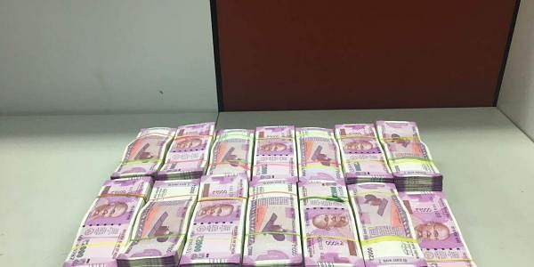 Rs 1.34 crore in denomination of Rs 2,000 currencies from five persons near Chennai airport. | EPS