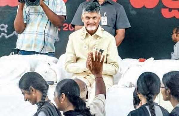 Chief Minister N Chandrababu Naidu greets visitors during his day-long hunger strike, Dharma Porata Deeksha, in Vijayawada on Friday | RVK RAO