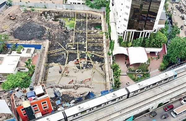 An aerial view of the site where the under-construction building collapsed in Kaloor on Thursday. The accident resulted in traffic chaos on Friday | Albin mathew