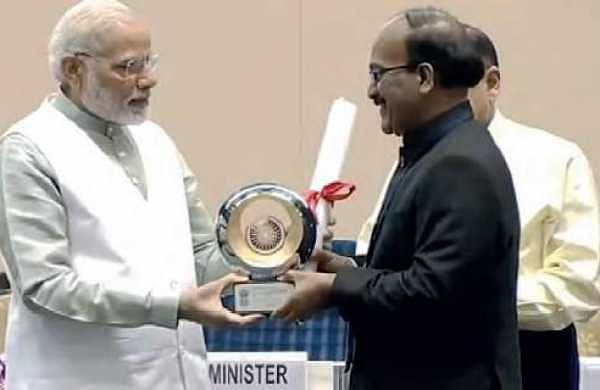 GHMC Commisioner B Janardhan Reddy receiving Prime Minister Award for Excellency from PM Narendra Modi in New Delhi on Saturday  | Express