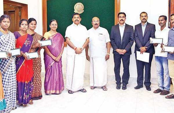 Chief Minister Edappadi K Palaniswami along with fishermen families during the distribution of financial assistance at the Secretariat on Friday | Express