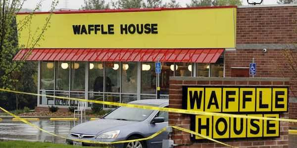 Police tape blocks off a Waffle House restaurant Sunday, April 22, 2018, in Nashville, Tenn. At least four people died after a gunman opened fire at the restaurant early Sunday. | AP