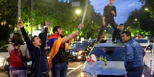 People celebrate Armenian Prime Minister's Serzh Sargsyan's resignation in Republic Square in Yerevan, Armenia. | AP