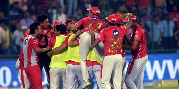 Kings XI Punjab cricketers cerebrate their victory against Delhi Daredevils during the IPL T20match at Ferozshah Kotla in New Delhi. | PTI