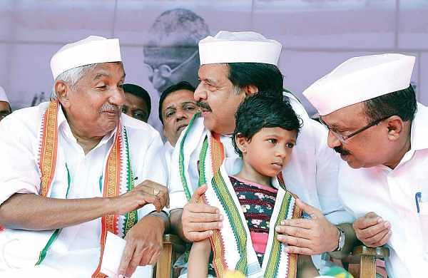 Ramesh Chennithala holds a kid during his 24-hour fast demanding a CBI probe into the custodial death of Sreejith, in Kochi on Monday. | Melton Antony