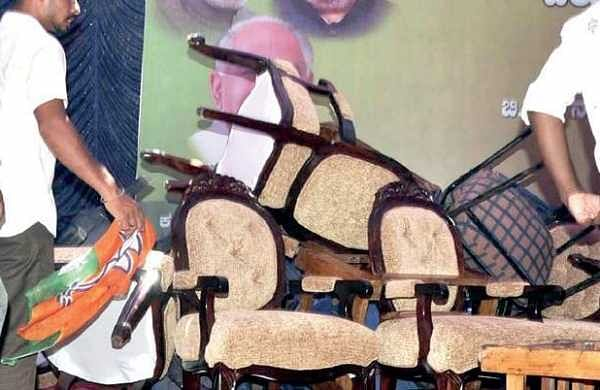 BJP workers show their anger by breaking chairs in Nanjangud soon after  B S Yeddyurappa announced that his son Vijayendra will not contest assembly elections from Varuna, on Monday  |  s udayshankar