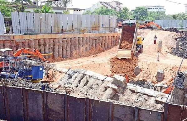 Red soil being filled in the area where the building structure collapsed in Kaloor to ensure that the nearby building don't face any problem  | Albin Mathew