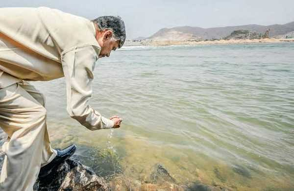 CM N Chandrababu Naidu scoops up water from River Godavari at Polavaram in West Godavari district on Monday | Express