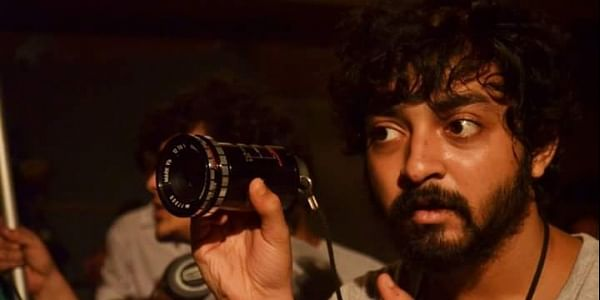 Director Sounak Kar shooting the film. (Image Courtesy Facebook)