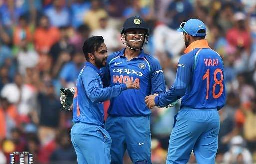 Indian wicket keeper Mahendra Singh Dhoni celebrates with Kedar Jadhav and captain Virat Kohli after the wicket. | File AFP
