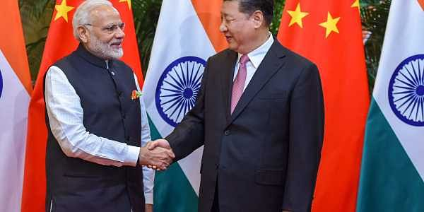Prime Minister Narendra Modi shakes hands with Chinese President Xi Jinping during his visit in Wuhan China on Friday. | PTI