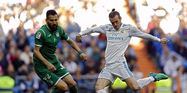 Real Madrid's Gareth Bale, right, shoots the ball next to Leganes' Dimitrios Siovas during a Spanish La Liga soccer match between Real Madrid and Leganes at the Santiago Bernabeu stadium in Madrid. | AP