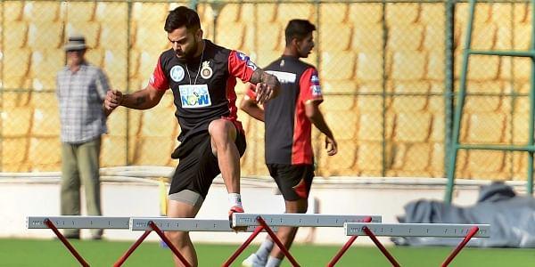 Royal Challengers Bangalore skipper Virat Kohli during a practice session ahead of IPL 2018 at Chinnaswamy Stadium in Bengaluru. | PTI
