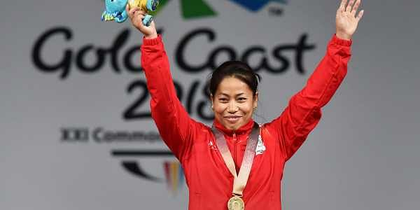 Gold medalist Indian weightlifter Sanjita Chanu poses for a photo during the medal ceremony of women's 53kg Weightlifting event during the Commonwealth Games 2018. | PTI