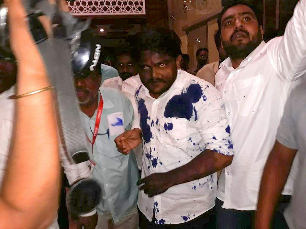 Man throws ink on Hardik Patel, held