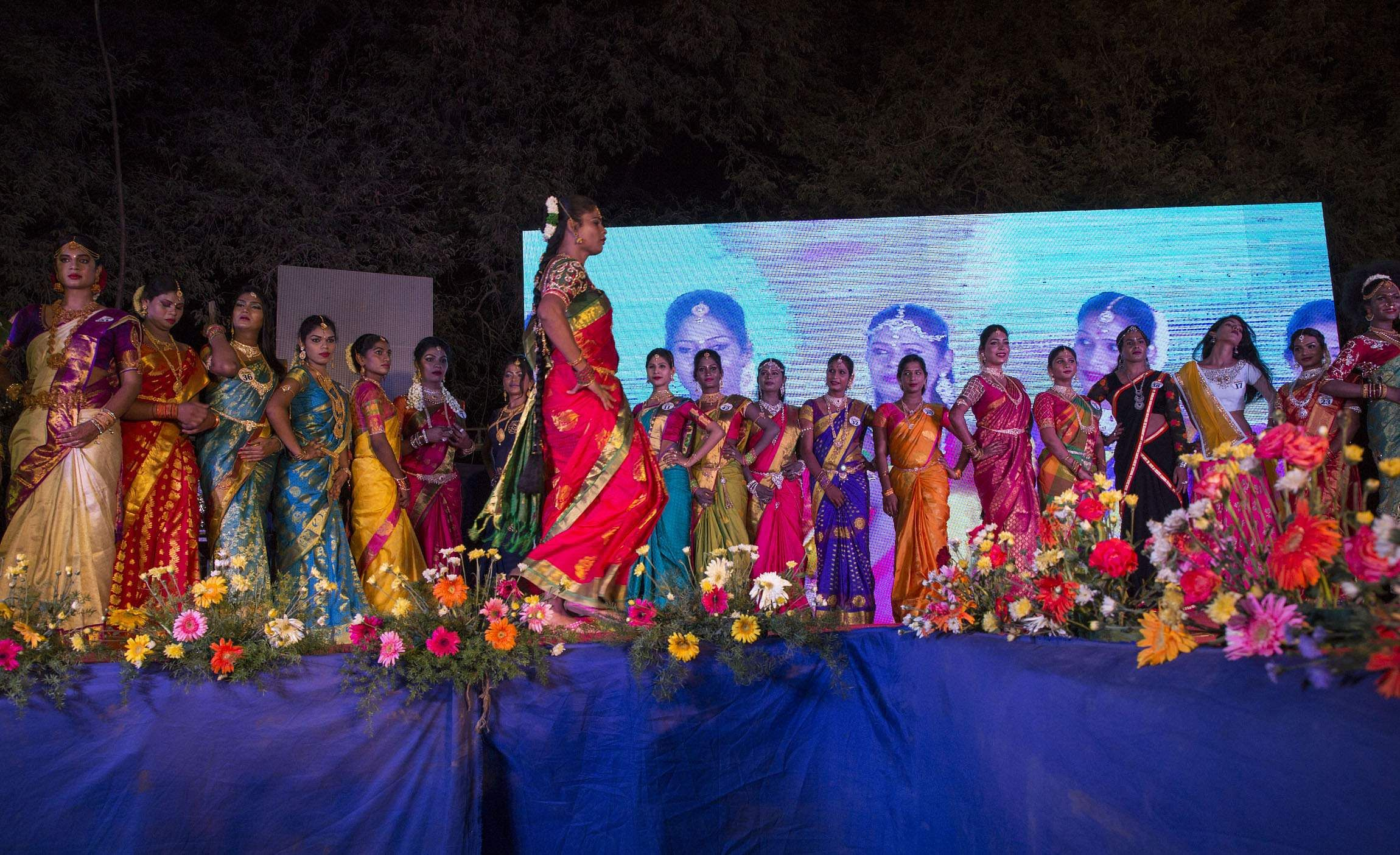 Transgenders dressed in sarees walk the ramp during the 'Miss Koovagam 2018' contest. At the end of the contest, judges crown the most beautiful among them as the winner. (EPS | G Pattabiraman)