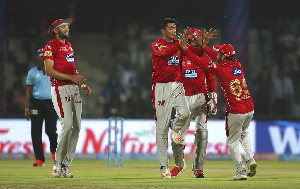 Mujeeb Ur Rahman second left has played in KXIP's 11 games in IPL 2018. | File