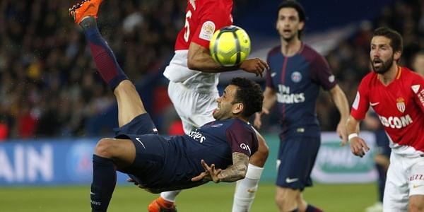 Paris Saint Germain's Dani Alves tries to score with a bicycle kick during the French League One match against Monaco. (AP)