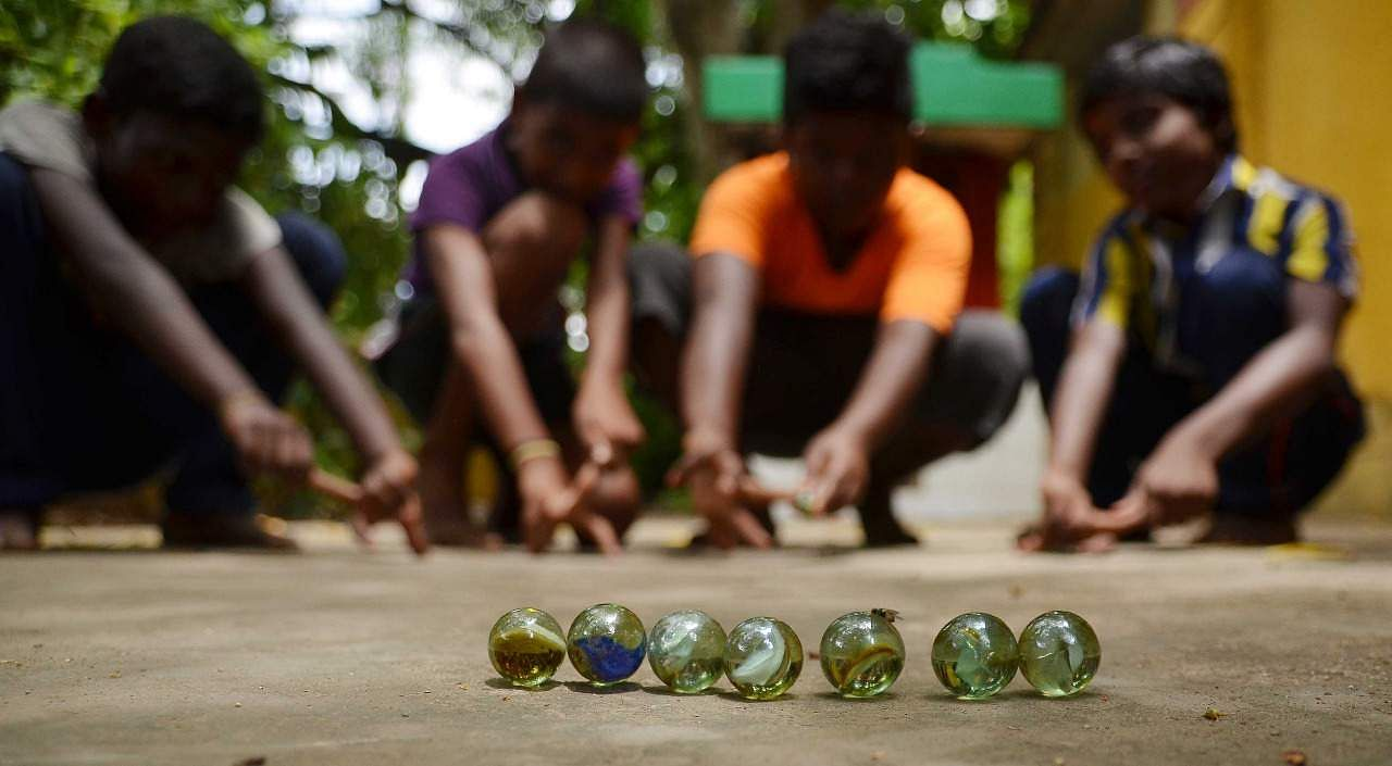 Summer camp for Traditional games for student being held at district library Palaymkottai in Tirunelveli. EXPRESS PHOTO /V.KARTHIKALAGU