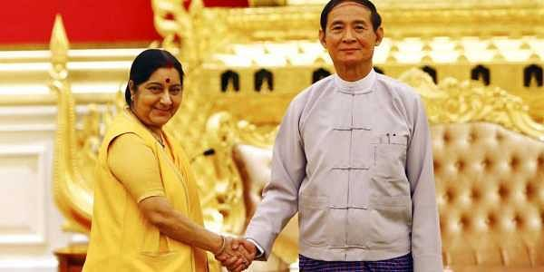 Myanmar's President Win Myint, right, shakes with visiting Indian External Affairs Minister Sushma Swaraj during their meeting at the President House in Naypyitaw, Myanmar. | AP