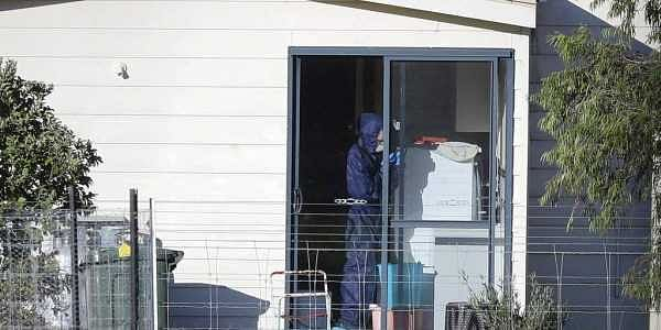 Police forensics investigate the death of seven people in a suspected murder-suicide in Osmington, east of Margaret River, south west of Perth.   AP