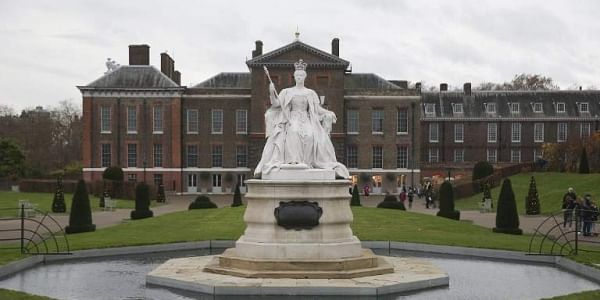 In this file photo taken on November 27, 2017 A marble statue of Britain's Queen Victoria is pictured in the gardens of Kensington Palace in west London. | AFP