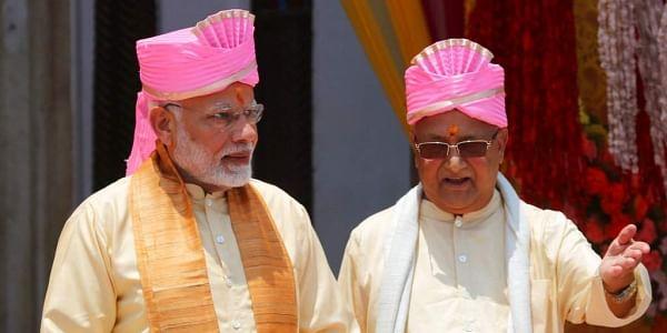 Nepalese Prime Minister Khadga Prasad Oli, right, and Indian Prime Minister Narendra Modi visit the Janaki Temple, a revered Hindu temple in Janakpur, Nepal. | AP