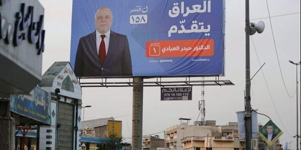 In this Thursday, May 3, 2018 photo, campaign poster of Iraqi Prime Minister Haider al-Abadi in seen in Baghdad, Iraq. | AP