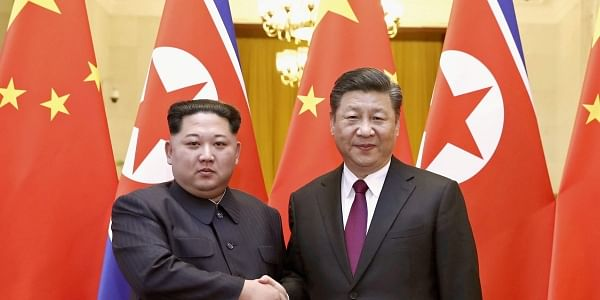 North Korean leader Kim Jong Un, left, and Chinese President Xi Jinping shake hands in Beijing, China. | AP