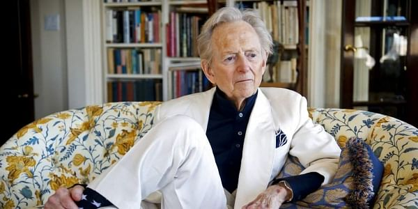 FILE - In this July 26, 2016 file photo, American author and journalist Tom Wolfe, Jr. appears in his living room during an interview about his latest book, 'The Kingdom of Speech,' in New York. Wolfe died at a New York City hospital. | AP