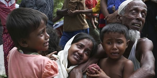 A group of Muslim Rohingyas in Ghumdhum, Cox's Bazar weep as Bangladesh border guards (not pictured) order them to leave their makeshift camp and force them out of the country on August 28, 2017. Since 2012, more than 1,000 Rohingya have been killed, some