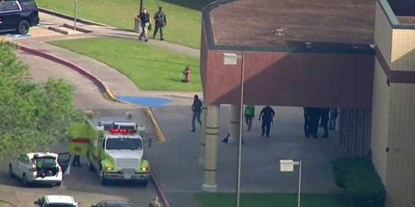 In this image taken from video law enforcement officers respond to a high school near Houston after an active shooter was reported on campus. | AP