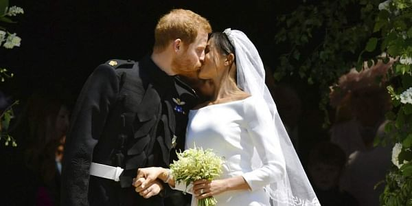 Prince Harry and Meghan Markle leave after their wedding ceremony at St. George's Chapel in Windsor Castle in Windsor, near London, England. | AP