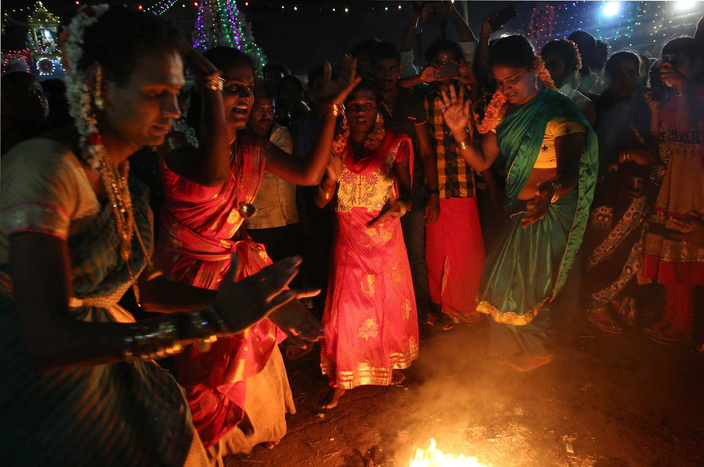 Transgenders perform their traditional 'kummi adi' dance near Koothandavar temple after getting 'married'. The Koovagam festival culminates on the night of the full moon (Chitra Pournami). (in picture: Transgenders near Koothandavar temple minutes before getting married on Tuesday evening) |  Express Photo by G Pattabiraman