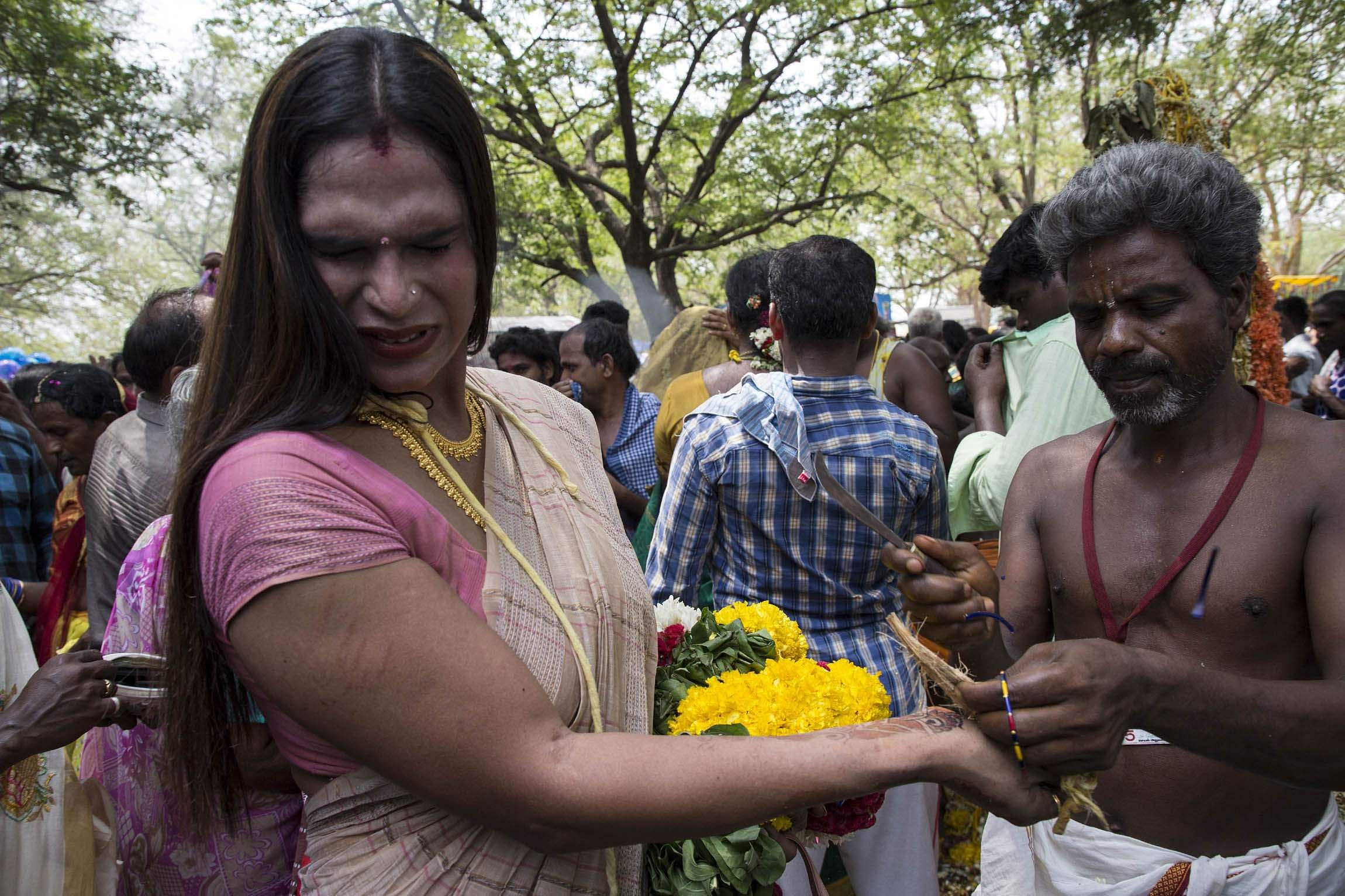 A Transgender reacts as her bangles are removed along with her Thaali to mourn the death of Aravan. (Express Photo | G Pattabiraman)