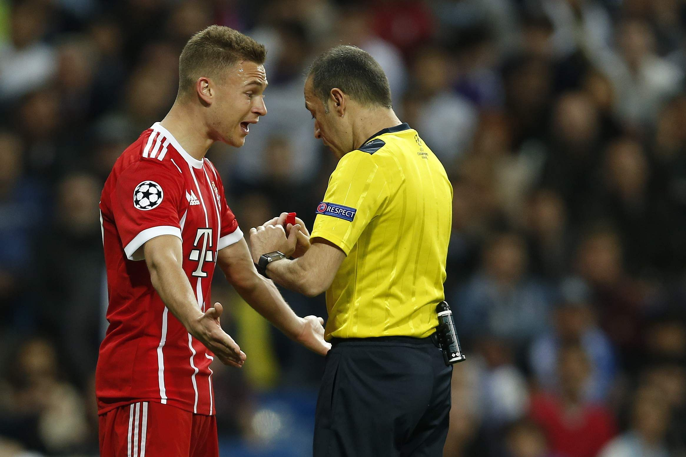 Bayern's Joshua Kimmich argues to Turkish referee Cuneyt Cakir during the Champions League semifinal second leg match between Real Madrid and FC Bayern Munich. (AP)