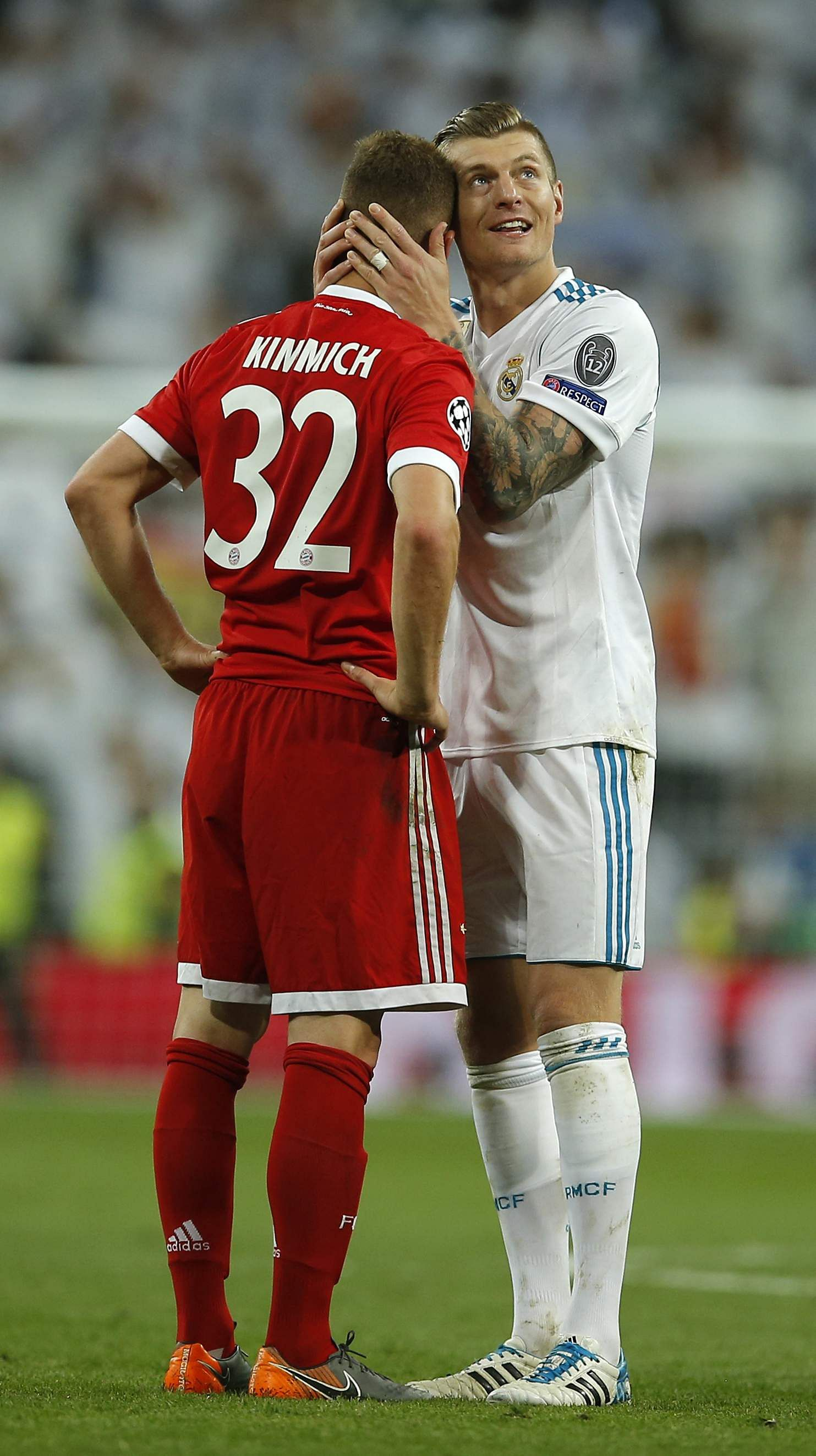Real Madrid's Toni Kroos comforts his fellow countryman Bayern's Joshua Kimmich, left, after Real reached its third straight Champions League final. (AP)